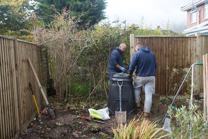 A photo of two men from the fence installation team putting up a new closeboard fence
