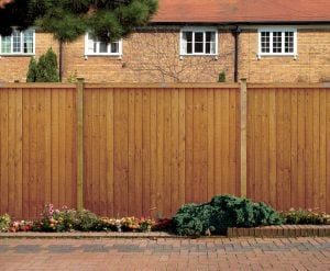 A photo of a gold closeboard fence panels