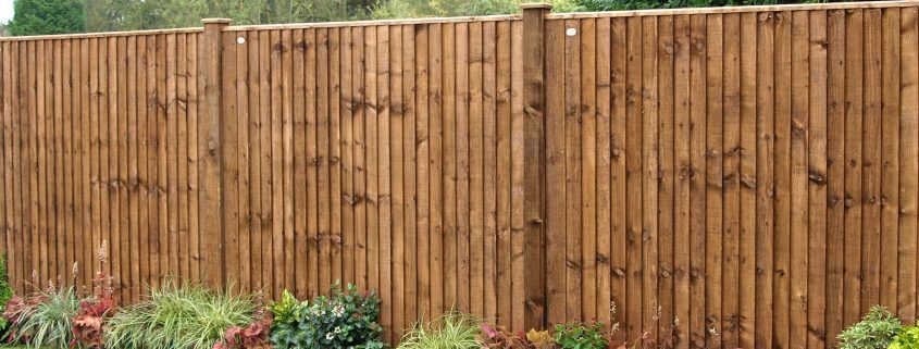 A photo of brown closeboard fence panels in a garden