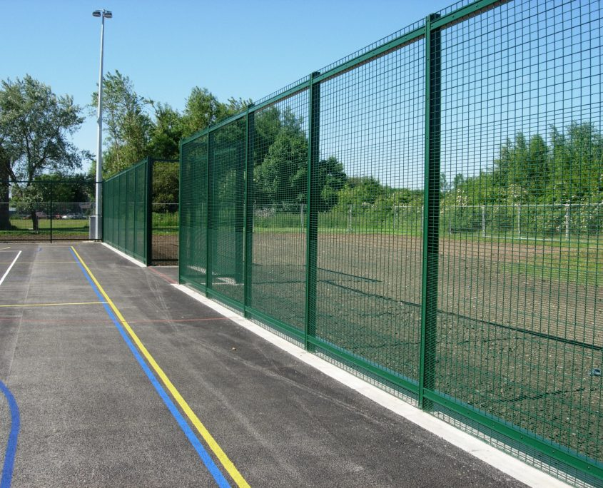 A photo of ball court fencing for a School