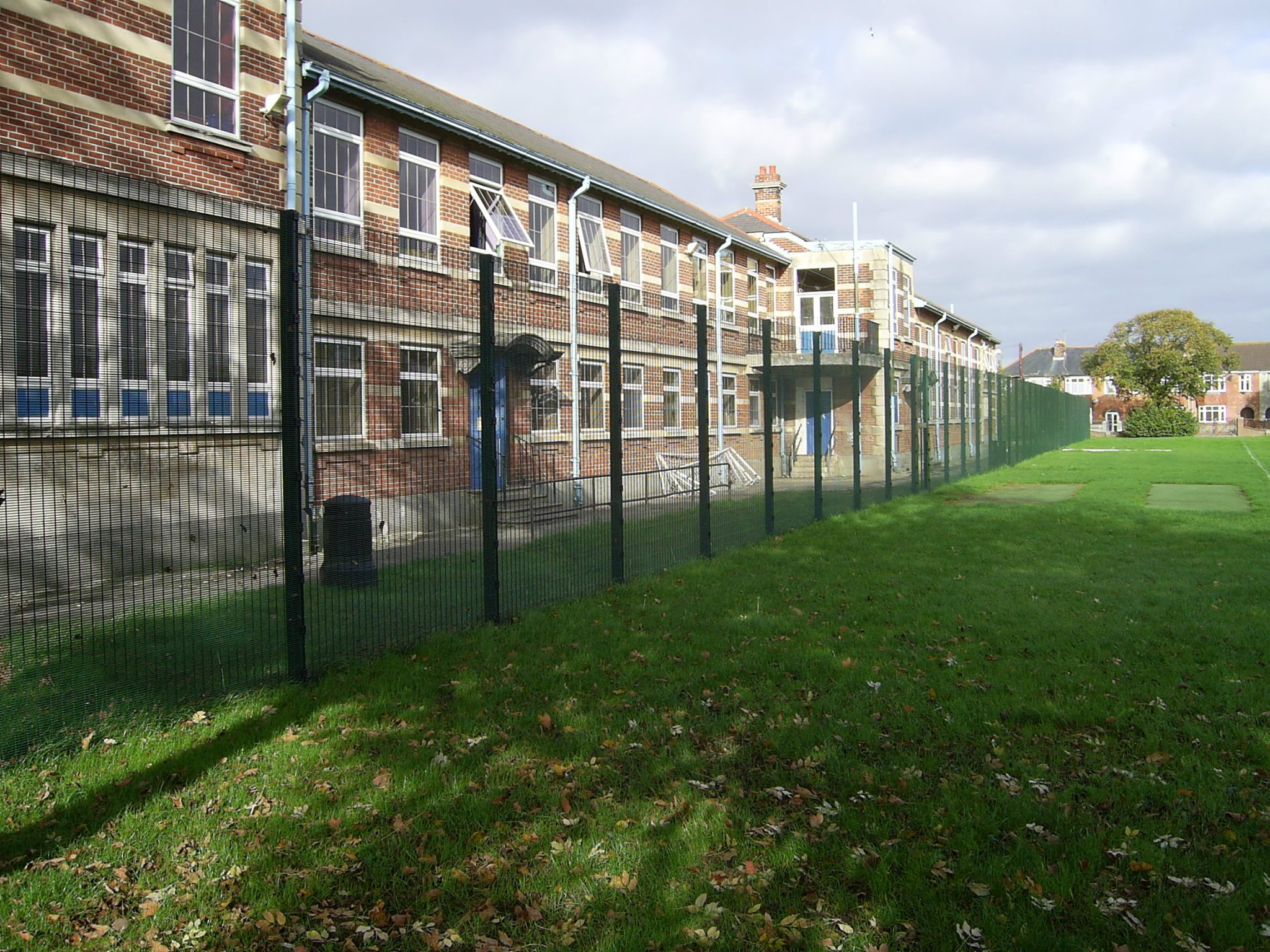 A photo of fencing installed for a School