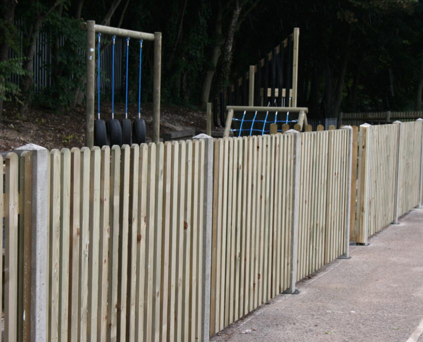 A photo of picket fencing for a School