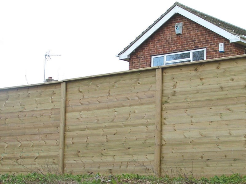 A photo of a fence in front of a house