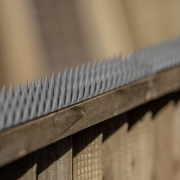 close up shot of grey prikka strip installed on a fence panel