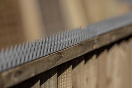 close up shot of grey prikka strip installed on a fence panel