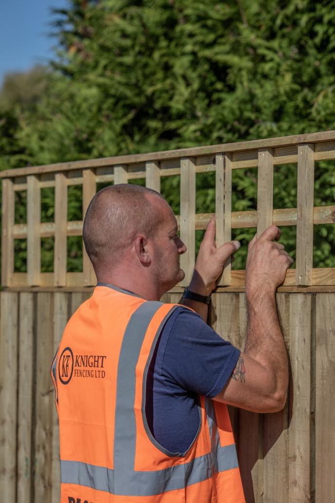 fitting trellis onto a fence panel