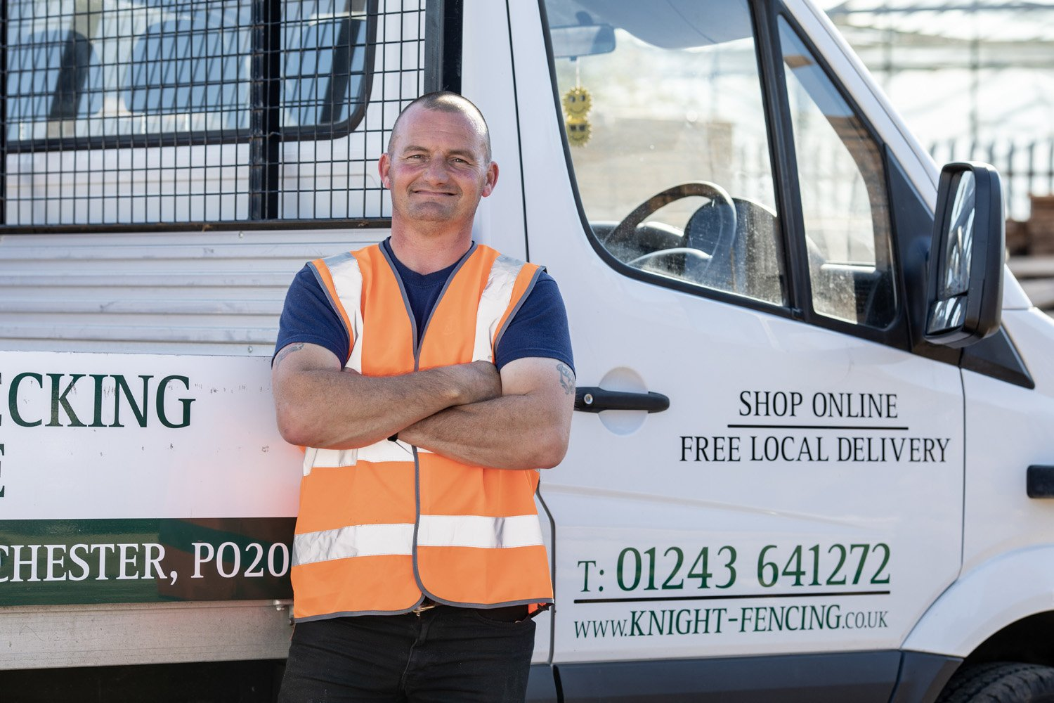 a man stood in front of the knight fencing truck