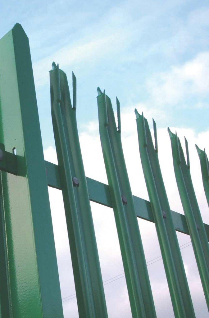 A photo of a green metal fence