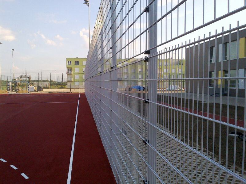 A photo of a fence around a ball court