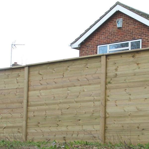 acoustic fencing in front of a house