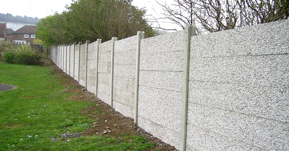 A photo of a Concrete panel wall fence