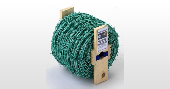 A photo of a reel of green barbed wire