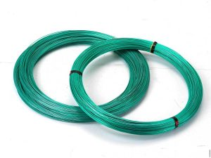 A photo of two coils of green metal wire