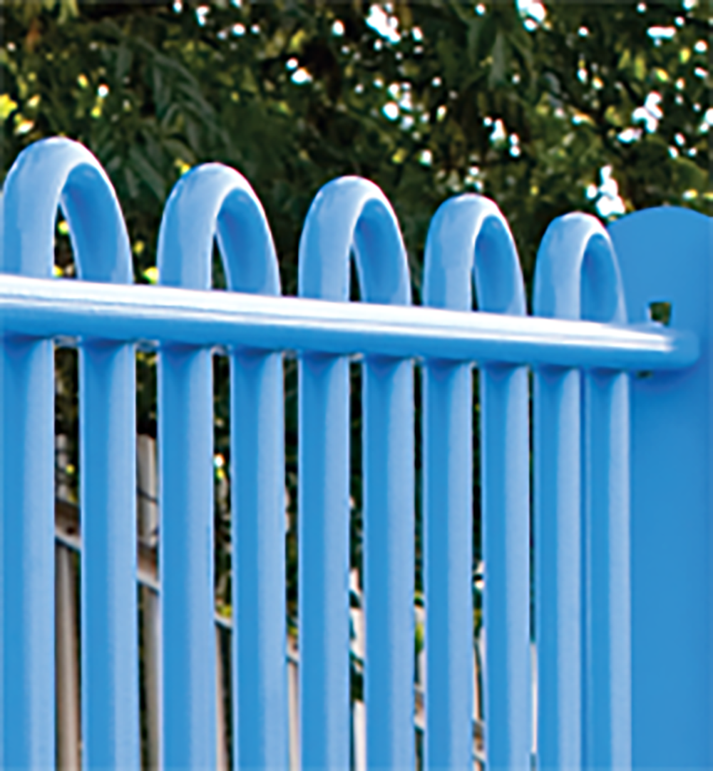 A photo a blue ultrabar railing fence in a park setting